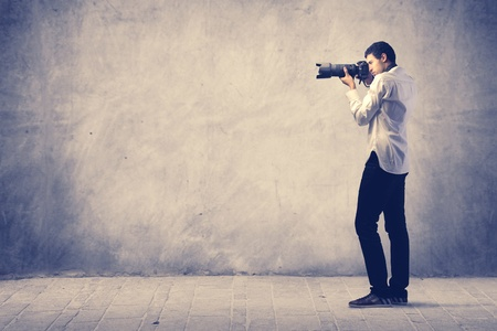 telephoto: Photograph holding a reflex camera Stock Photo