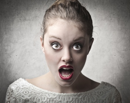 stupor: Beautiful woman with astonished expression Stock Photo