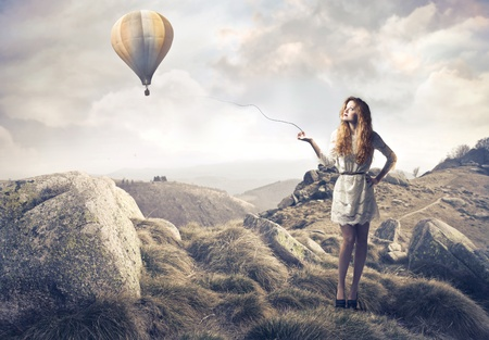hot air ballon: Beautiful woman with hot-air balloon in the background