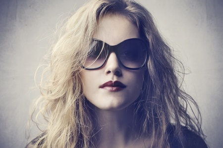 Beautiful woman wearing fashion sunglasses photo
