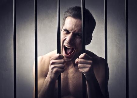 Desperate man in prison Stock Photo - 12394060