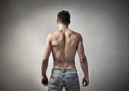 back muscles: Rear view of a bare-chested muscular man
