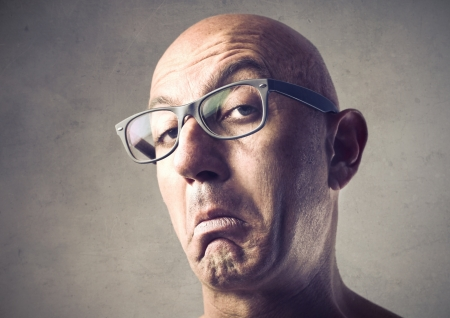 expression: Bald man with snobbish expression Stock Photo