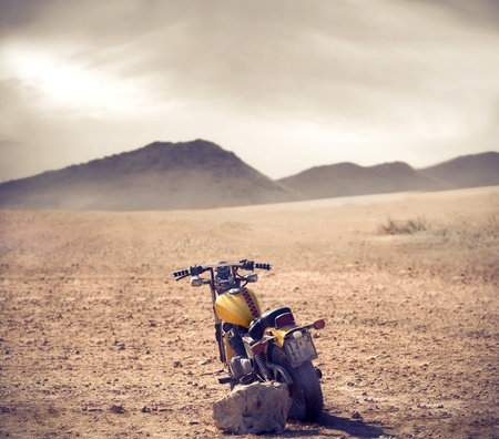 Motorcycle in a wild landscape photo