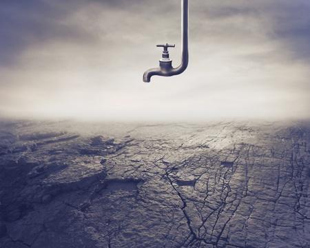 agua grifo: Cerrado del grifo sobre un paisaje secados al sol Foto de archivo