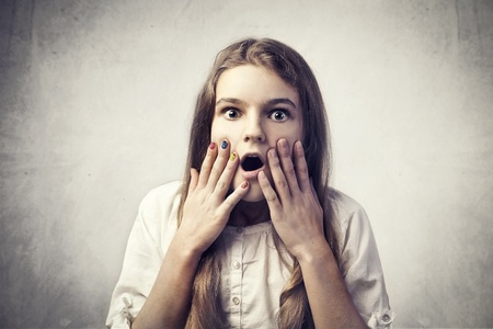 stupor: Teenage girl with astonished expression Stock Photo