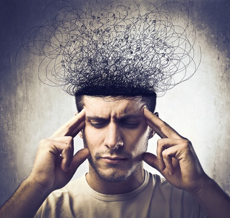 brain work: Young man with thoughtful expression and head melting into tangled lines Stock Photo