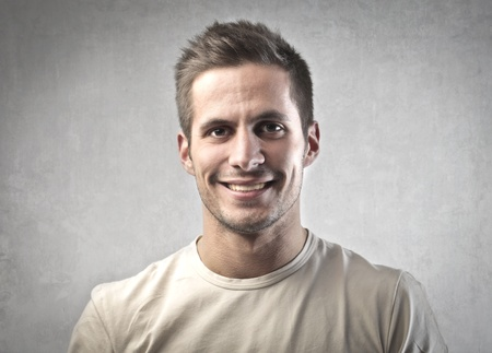 young boy smiling: Portrait of a smiling young man Stock Photo