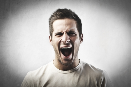 screaming head: Angry young man screaming Stock Photo