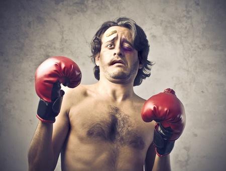 pugilist: Boxeador herido, con expresi�n asustada