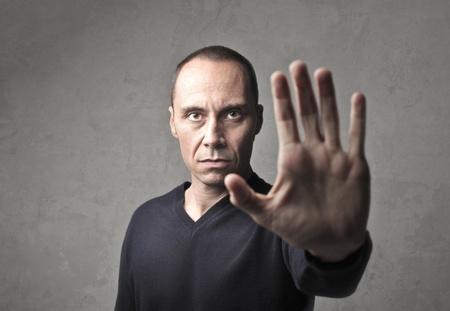 halt: Man indicating to halt with his hand