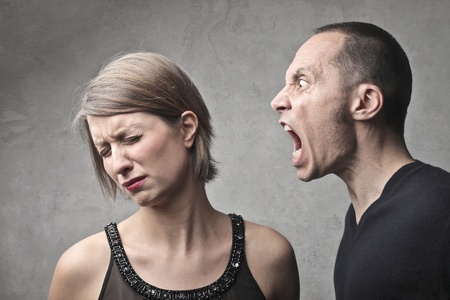 quarrel: Man screaming against his sad wife Stock Photo