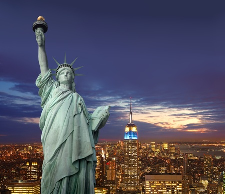 Statue of Liberty with night vie of New York in the background photo