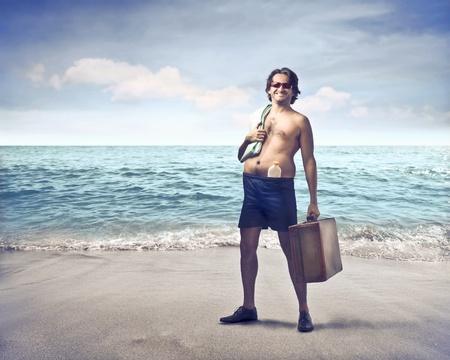 ironic: Smiling man at the seaside
