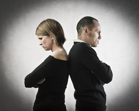 hate: Angry husband and wife turning their back on each other