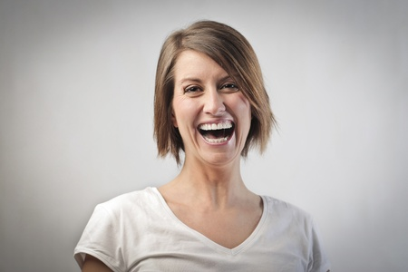 amused: Laughing young woman Stock Photo