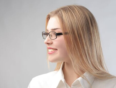 Profile of a smiling young business woman photo
