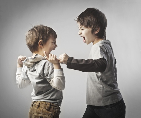 anger kid: Two brothers quarreling Stock Photo