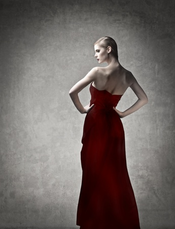 Beautiful elegant woman in red evening gown photo