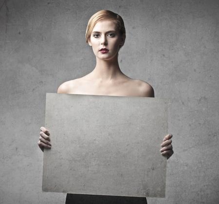 spoiled: Beautiful woman holding a white billboard