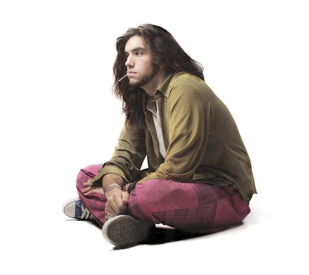 man smoking: Young man smoking a cigarette