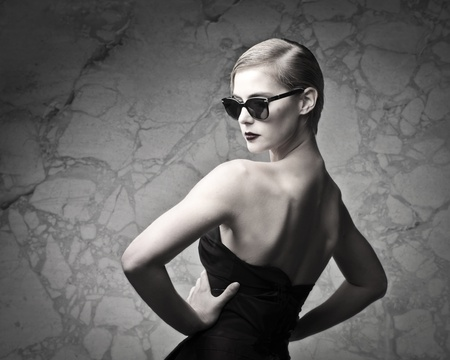 eyewear: Beautiful elegant woman on marble background Stock Photo