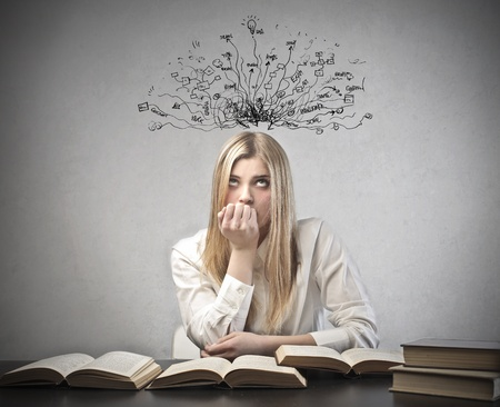 preoccupation: Young student with thoughtful expression and tangled lines and symbols coming out of her head