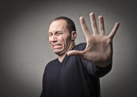 scare: Scared man stopping someone with his hand