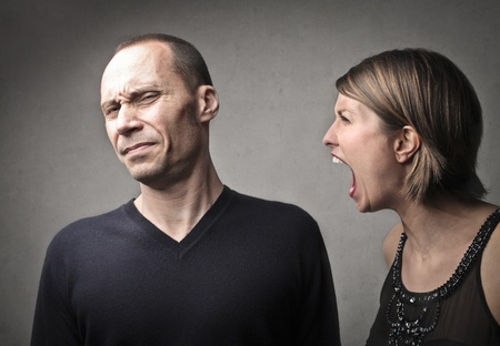 angry woman screaming against her husband Stock Photo