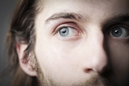man s: Closeup of a handsome man s blue eyes