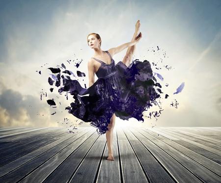 Beautiful ballerina with her dress melting away  photo