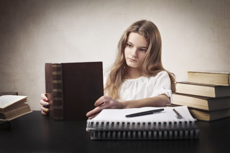Bored teenage girl studying Stock Photo - 13011179