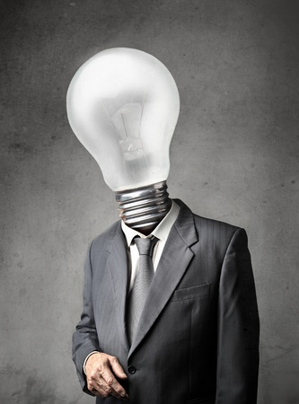 Businessman with a light bulb instead of his head photo