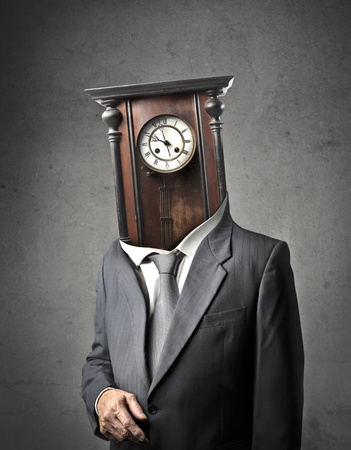 Businessman with a pendulum instead of his head photo