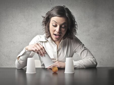 conjuring: Young woman playing conjuring tricks Stock Photo