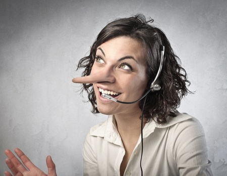 Smilng saleswoman with long nose talking on the telephone  Stock Photo - 13037655