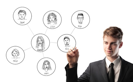 Smiling young businessman sketching portraits of diverse people Stock Photo - 13114304