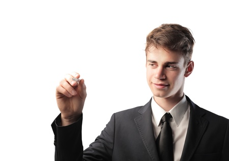 Smiling young businessman writing Stock Photo - 13114270
