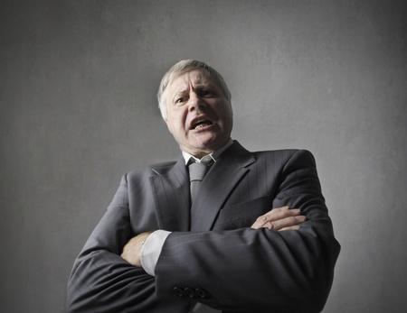 business concern: Angry senior businessman quarreling