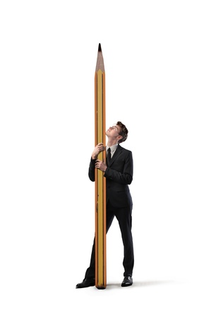 body dimensions: Isolated young businessman holding a big pencil Stock Photo