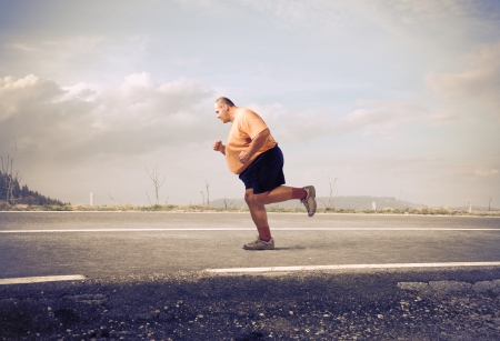 run way: Overweight man jogging on a country road