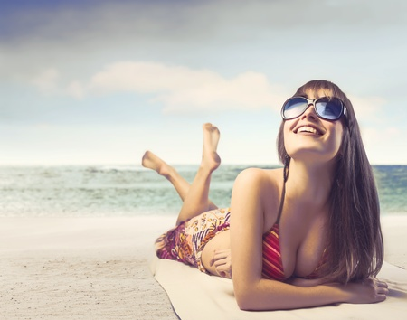 Smiling beautiful woman at the seaside Stock Photo - 13157852