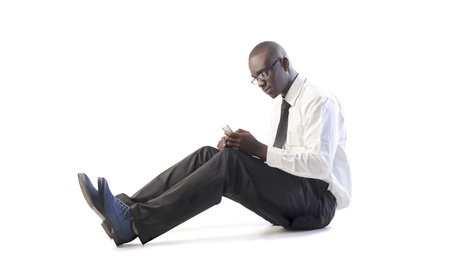 Isolated african businessman using a mobile phone photo