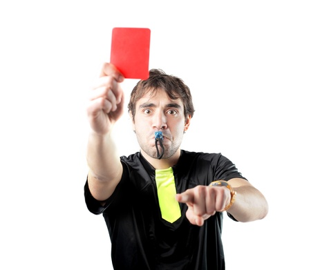expel: Isolated referee whistling and raising a red card Stock Photo