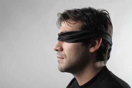 blindfolded: Profile of a blindfolded man
