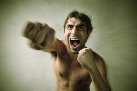 pugilist: Aggressive man punching