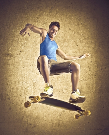 enables: Smiling young man skateboarding