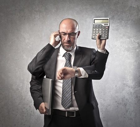 phone the clock: Busy businessman with four arms Stock Photo