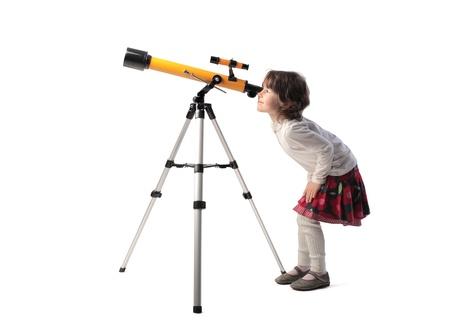 Little girl looking into a telescope (telescope, child,\ curiosity)