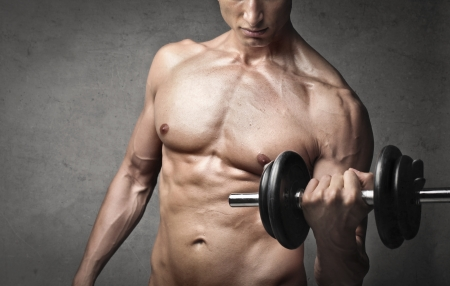 Closeup of a muscular man lifting weights Stock Photo - 14068118